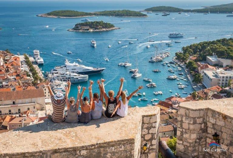 Sail Croatia passengers overlooking Hvar harbour